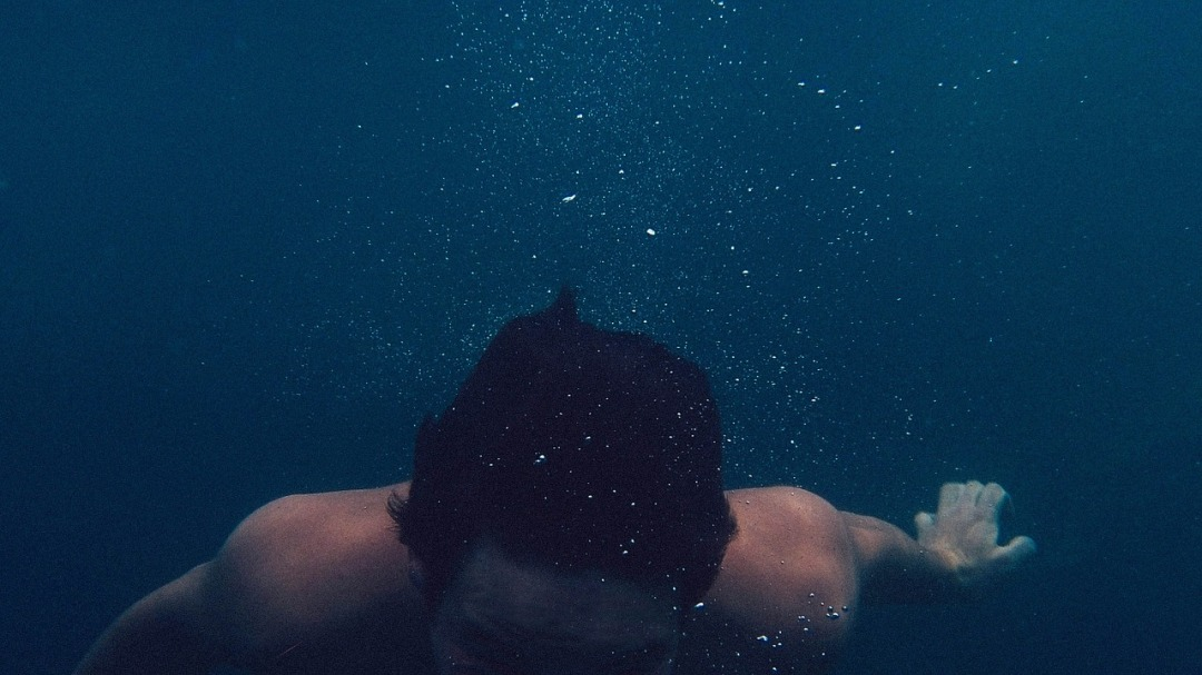 Photo of man swimming in the ocean